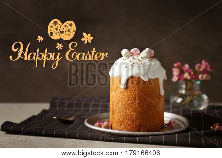 Plate with sweet cake on table. Text HAPPY EASTER on background
