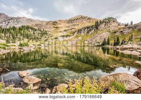 Closeup of Cecret lake with mountains in Albion Basin Utah
