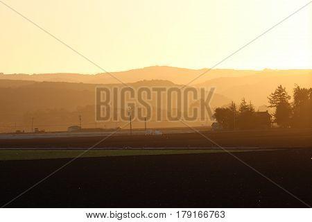 Salinas valley sunset in California golden sky