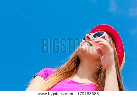 Woman Wearing Heart Shaped Sunglasses And Hat