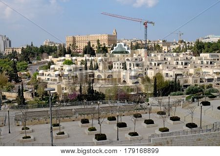 JERUSALEM ISRAEL - MARCH 25 2017: View of the King David Hotel and elite residential complex from the walls of the Old City of Jerusalem