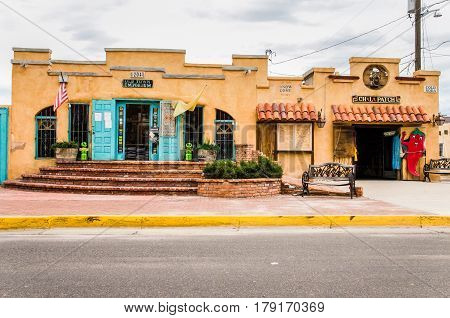 Albuquerque USA - July 28 2015: Old town plaza at hidden patio with Emporium shop and decorative sidewalk with brick paths and gardens