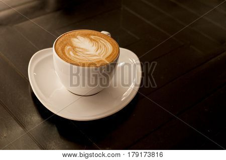 Coffee cup of cafe latte with latte art on top