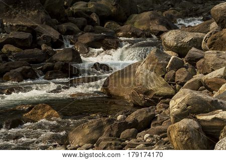 Nice River water flowing through stones and rocks at dawn