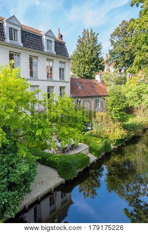 Beautiful inner yard on the bank of canal in town of Bruges Belgium