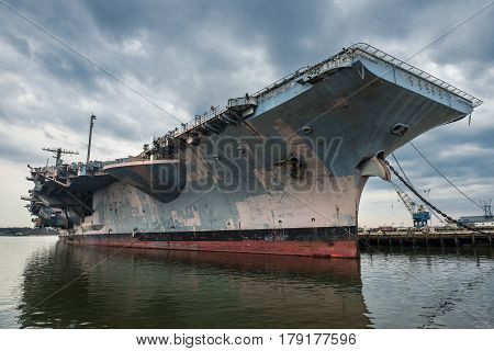 US Navi aircraft carrier warship in the port