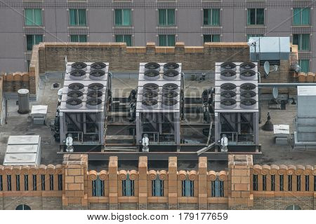 Air Conditioner ventilation system on building rooftop. Aerial view to AC system on skyscraper.