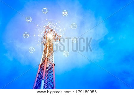 Telecommunication tower on blue sky background with icon of internet e-mail cloud technology smart phone computer wireless signal and banking. The concept of connecting to online service