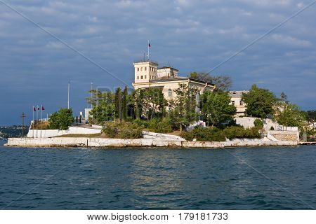 Sevastopol, Russia - June 09, 2016: Admiral building of the hospital of the Black Sea Fleet named after Pirogov on Pavlovsky cape in the South bay of Sevastopol