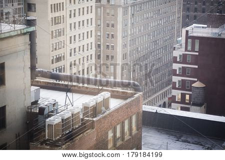 Close up view of AC air cooling units on rooftop of building in New York City.
