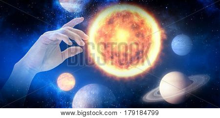 Hand of man pretending to touch an invisible screen against graphic image of various planets 3d