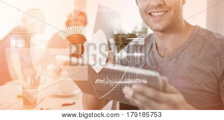 Digital interface against black background against smiling business executive using digital tablet 3d