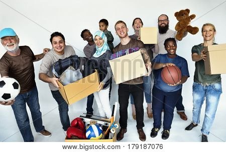 Group of volunteer people donate stuff for charity
