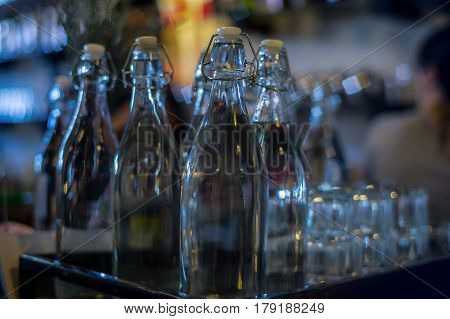 A display of various empty glass bottles