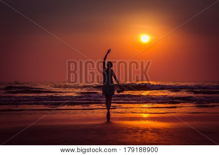Amazing Sunset Portrait Of The Silhouette Woman In Arambol Beach, North Goa, India