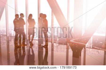 High angle view of illuminated cityscape against digitally generated image of business colleagues talking