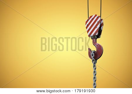 Studio Shoot of a crane lifting hook against yellow vignette