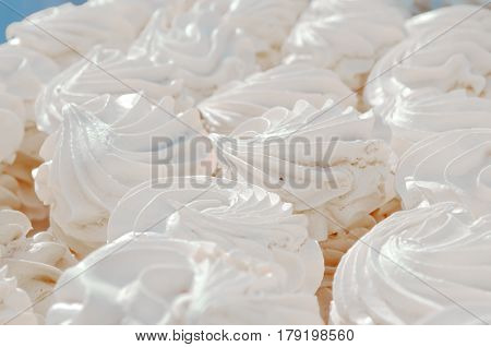 Many white aerial cakes meringue and marshmallows