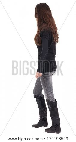 back view of going  woman  in  in jeans and sweater. beautiful brunette girl in motion.  backside view of person.  Rear view people collection. Isolated over white background.