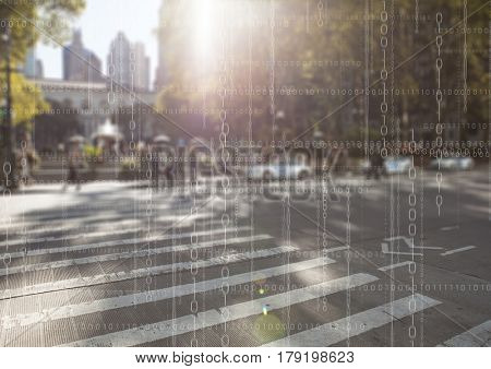 Digital composite of White binary code against blurry street with flare