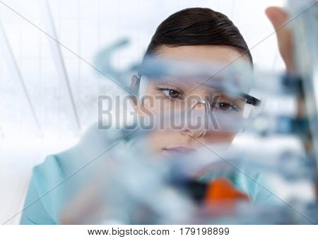 Digital composite of Close up of woman with electronics against blurry window