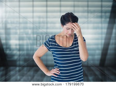 Digital composite of Stressed woman against windows