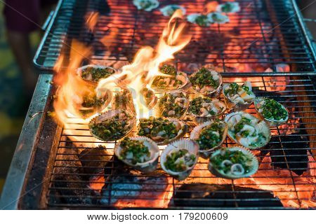 Clams grilled on a hot grill with fire