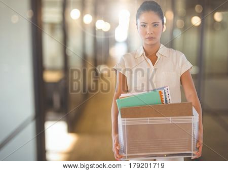 Digital composite of Unhappy Woman redundant with box against office