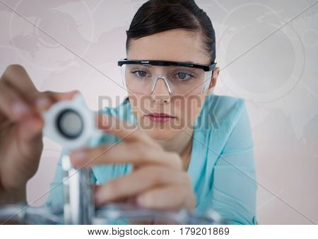 Digital composite of Close up of woman with electronics against white background with interface