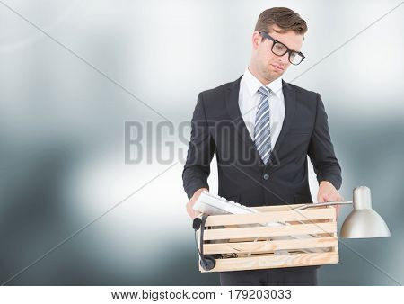 Digital composite of Sad redundant man job loss against blurred background