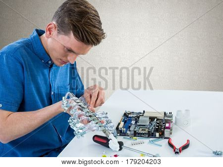 Digital composite of Man with electronics against grey wall