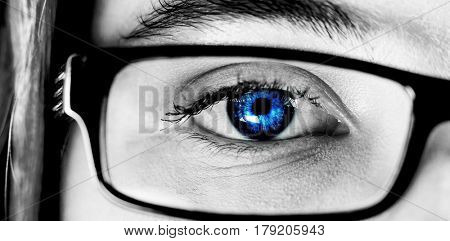 White background with vignette against eye of a woman wearing spectacles