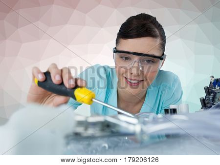 Digital composite of Woman with electronics against green and pink vector mesh