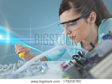 Digital composite of Woman with electronics against blue background with waves