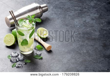 Mojito cocktail on dark stone table. With copy space for your text