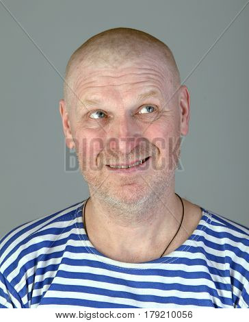 Portrait Of A Man In A Striped Vest