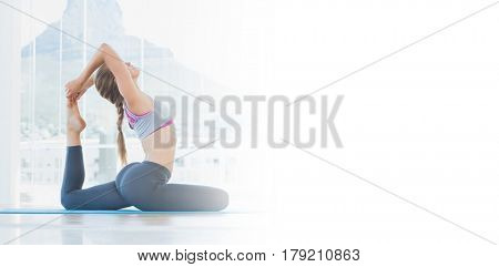 Full length side view of a fit young woman stretching body in exercise room