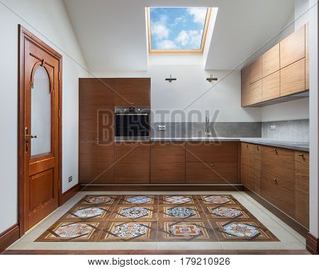Interior of modern kitchen with a roof window