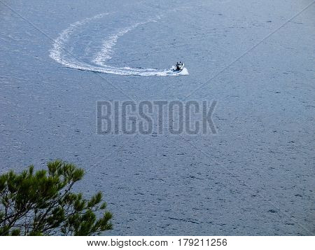 People on motor boat making a steep turn in the sea