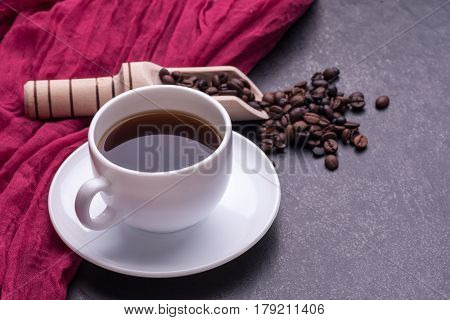 coffe in white cup on a black ceramic table