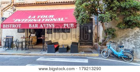 Antibes, France - June 29, 2016: day view of typical street with bistrot in Antibes France. Antibes is a popular seaside town in the heart of the Cote d'Azur.