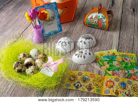 colored Easter egg decorated on the table in the holiday of light Christ is Risen in different colors and pictures and stickers iron-on transfers for eggs
