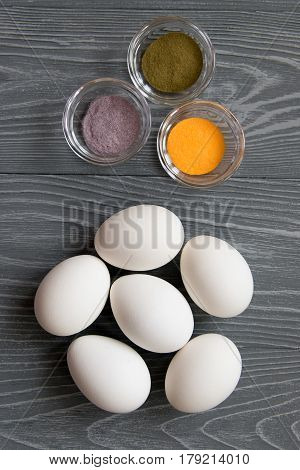 White Chicken Eggs And Color Dyes On A Gray Table. Celebrating Easter