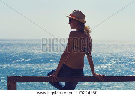 Girl enjoying the summer and with sea / ocean horizon.