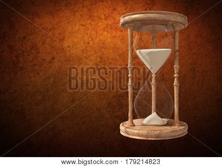Digital composite of Egg Timer with sand against brown background