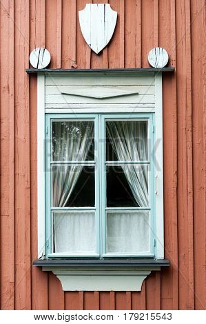 Decorated window of traditional wooden house in Helsinki, Finland