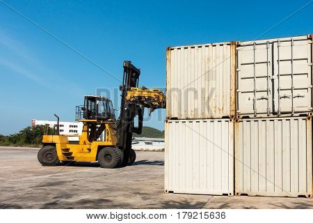 Container unloading truck in logistics yard., Shipping yard.