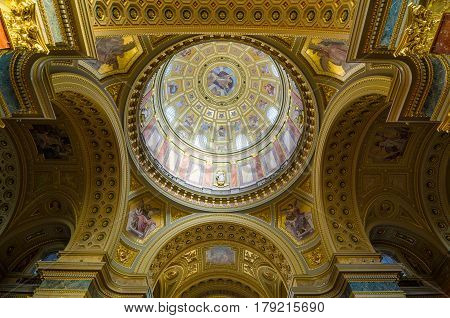 Interior Of The Cupola. Decorated Ceiling With Mural And Gold.
