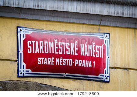 Old Town square (Staromestske Namesti). Traditional red street sign in Prague Czechia.