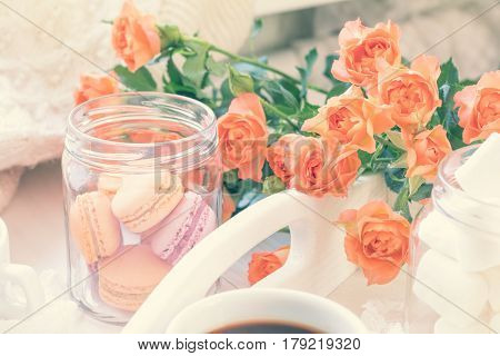 Orange Macaroons, Cup Of Coffee And Fresh Roses